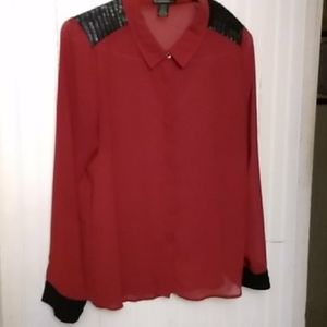 Semi sheer rust colored blouse with faux leather